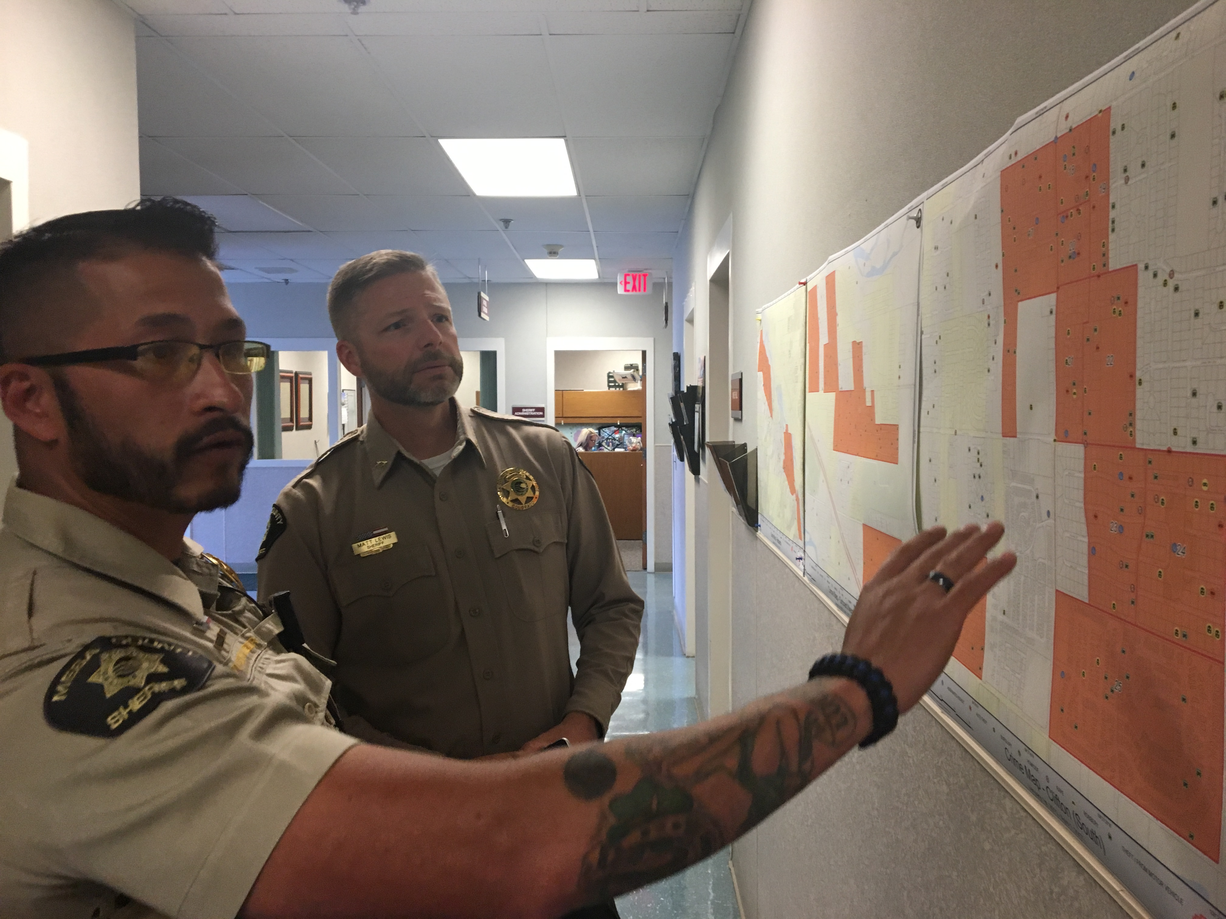 Deputies looking at map